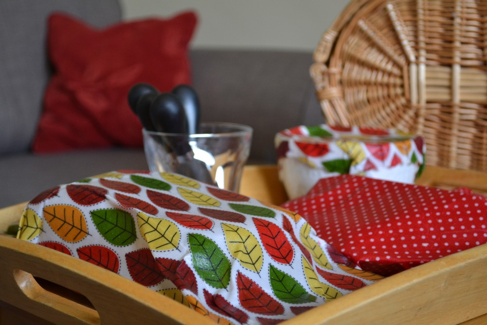 A tray of picnic items which are covered with beeswax wraps